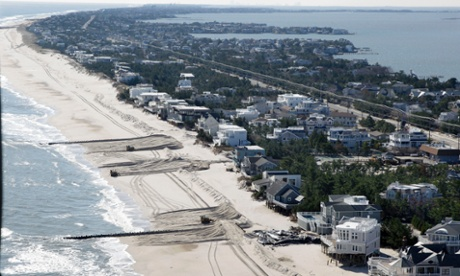 In this aerial photograph, heavy equipment continues working to restore a barrier dune along the Atlantic Ocean in Loveladies on Long Beach Island, N.J.,  November  9, 2012, after the region was pounded by Superstorm Sandy last week.