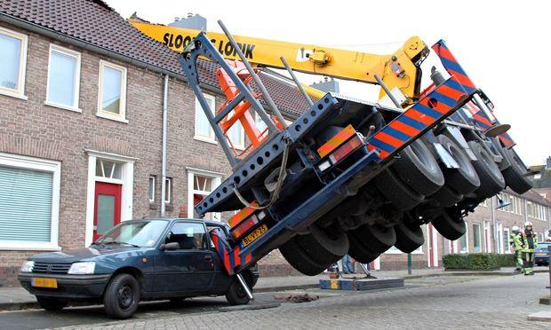 W Crane Guy Crane crashes through roof as