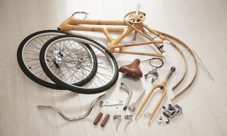 Parts of the Bamboo Bee build-it-yourself bicycle laid out on the floor