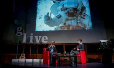 Chris Hadfield being interviewed by Guardian science editor Ian Sample at a Guardian Live event in London, December 2014