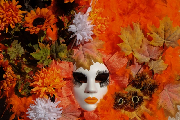 A masked reveller poses in Saint Mark's Square during the carnival in Venice. Photograph: Stringer/Reuters