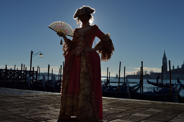 A costumed reveller poses in St Mark's square during the carnival in Venice. Photograph: Gabriel Buoys/AFP/Getty Images