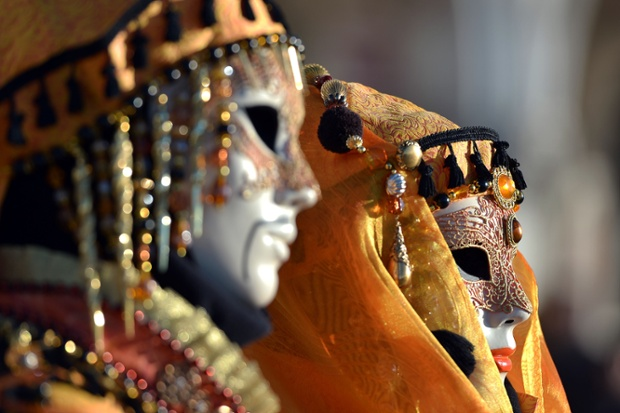 Costumed revellers pose in St Mark's square during the carnival in Venice. Photograph: Gabriel Buoys/AFP/Getty Images