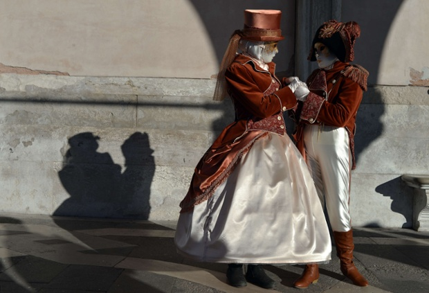 Costumed revellers pose near St Mark's square during the carnival in Venice. Photograph: Gabriel Bouys/AFP/Getty Images