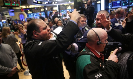 Traders buy Verizon shares on the floor of the New York Stock Exchange on February 24, 2014 in New York City.