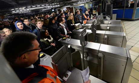Commuters wait for limited service tube trains during a strike, at Victoria Station.
