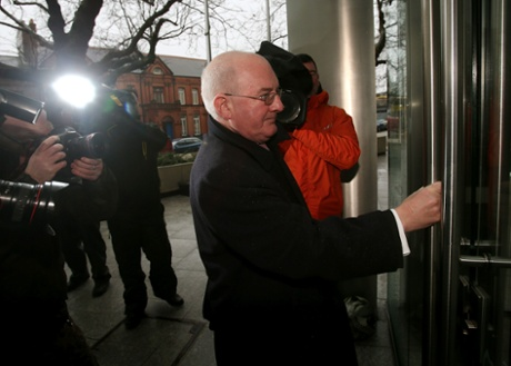 Willie McAteer, the former Finance Director of Anglo Irish Bank, arrives at the Circuit Criminal Court in Dublin.