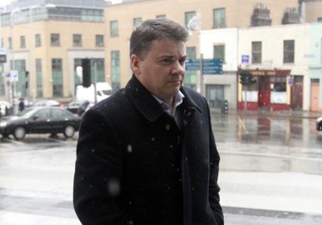 Former chief financial officer Anglo Irish Bank Pat Whelan arriving at Dublin Criminal Court, Ireland, Wednesday, Feb. 5, 2014.