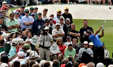 The crowd watches Tiger Woods of the US tee off during the second round of the US Masters