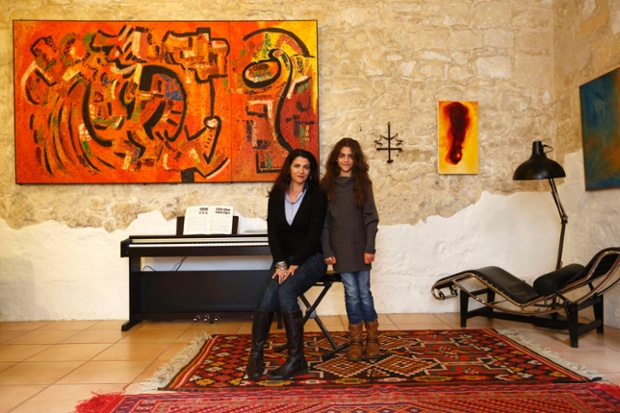 Charlotte Stafarce, 49, and her daughter Scarlett Stafarce, 9, pose in the living room of their home in Zebbug, outside Valletta, Malta. Charlotte is an actress and freelance drama teacher who finished her education at 17. Charlotte hopes her daughter will be a scientist when she grows up. Scarlett says she will finish education when she's about 25 and that she would like to be a vet.