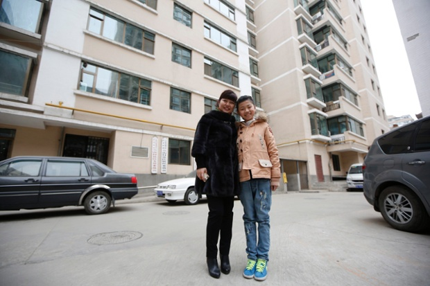 Zhang Haijing, 41, and her daughter Zhu Nuo, 11, pose for a photograph outside their apartment building in Lanzhou, Gansu province. Zhang Haijing finished her education at age 23 and is a mid-level manager for Xinhua Bookstore Group. When she was a child, she wanted to become a pre-school teacher. Zhang says she wants her daughter Zhu Nuo to have a stable job, but does not mind what she does so long as she is happy. Zhu Nuo says she wants to get a doctoral degree and become a professor.