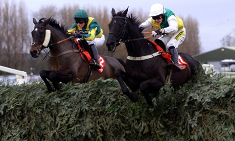Rebel Rebellion and Ryan Mahon (left) jumps alongside Gansey and Ryan Mania as they go on and win the Betfred Grand Sefton Chase over the Grand National fences during the Becher Chase Day at Aintree Racecourse, Liverpool in 2013