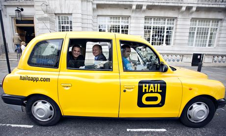 Gary Jackson, left, and Ron Zeghibe, co-founders of Hailo, in a London taxi cab.