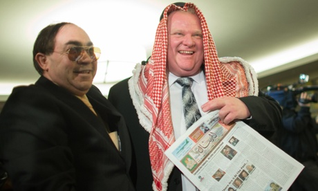 A supporter has his picture taken with Toronto Mayor Rob Ford wearing a keffiyeh.