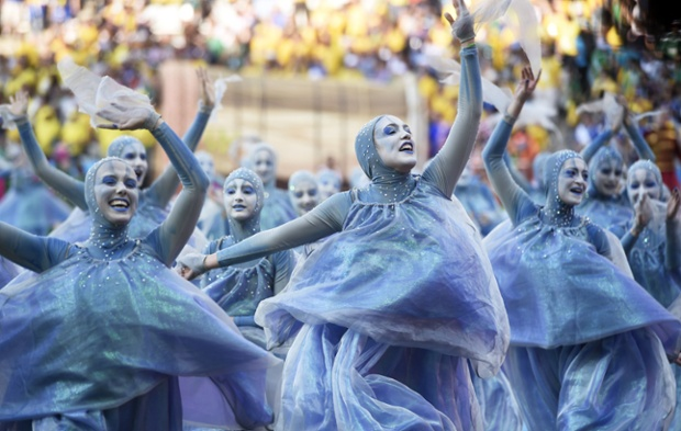 Dancers in blue costumes