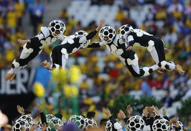 Acrobatic stunts by people dressed as footballs.