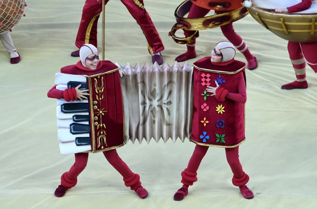 Two people share an accordian outfit