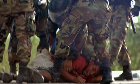 Peruvian security forces arrest a protester in June 2009 during conflict that led to more than 30 people dying and over 200 injured.