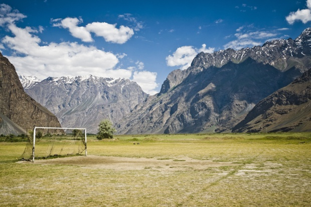 A remote pitch in Tajikistan with the Himalayas in the distance