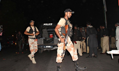 Pakistani rangers patrol outside Karachi airport following an attack by gunmen.