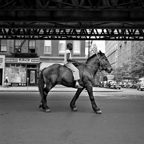 Vivian Maier portrait man rides horse in New York