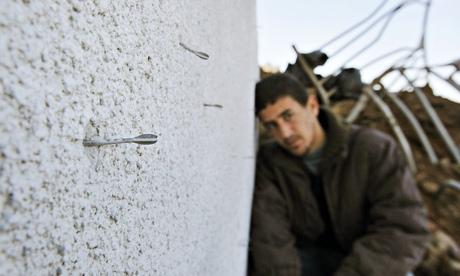 Flechette shell darts embedded in a wall in Gaza