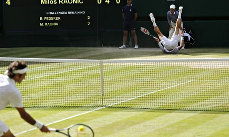 Milos Raonic of Canada falls over at Wimbledon