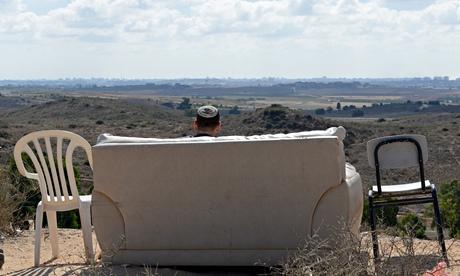 Israeli watches Gaza bombing from hillside sofa