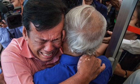 Two survivors cry after hearing the guilty verdict for former Khmer Rouge leaders for crimes against humanity.