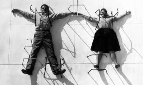 Grounded: Charles and Ray Eames posing with chair bases.