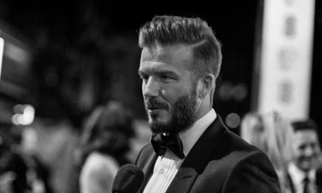 The 'impossibly perfect ultra-dad' David Beckham.