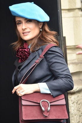 Salma Hayek arrives at the Gucci show on Wednesday.