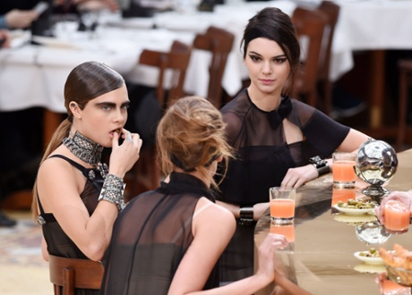 Cara Delevingne and Kendall Jenner at the bar during the show