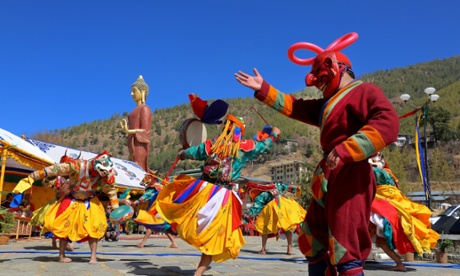 Costumed monks from Majuli, India, perform a traditional dance at the Bhutan International Festival.