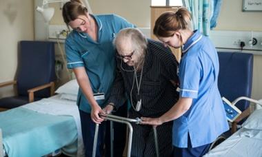 Elderly patient and two nurses