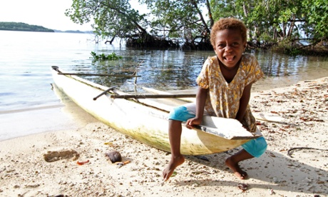 Girl on an outrigger canoe on Anelaua island, Papua New Guinea.