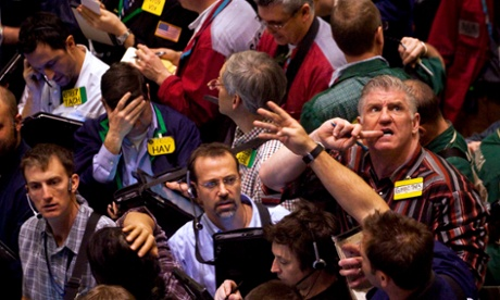 Traders work in the crude oil options pit at the New York Mercantile Exchange in New York, U.S., on  February 23, 2011. Oil surged to 0 a barrel in New York for the first time in two years as Libya's violent uprising threatened to disrupt exports from Africa's third-biggest supplier and spread to other Middle East oil producers.