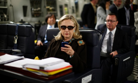 In 2011, Hillary Clinton wears sunglasses inside a C-17 military plane bound for Tripoli