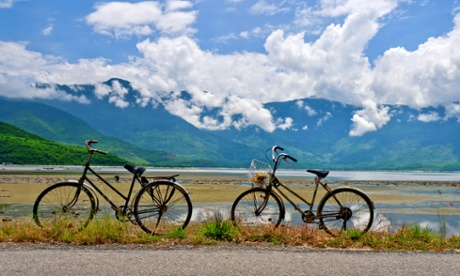 Hai Van Pass21 Aug 2011 --- Two Bicycles Parked in Front of Mud Flats and Mountains, Lang Co, Vietnam --- Image by Rob Whitworth/CorbisadventureAnnamite RangeAsiaaway from it allbicyclebicyclingDa NangEast Asian cultureEastern AsianHai Van PassIndochinaLang Comountainmud flatsNghe An ProvincenobodyNorth Central Coast RegionoutdoorsridingscenicSoutheast AsiaSoutheast Asian culturetogethernesstraveltravel & tourismvehicleVietnamVietnamese culture