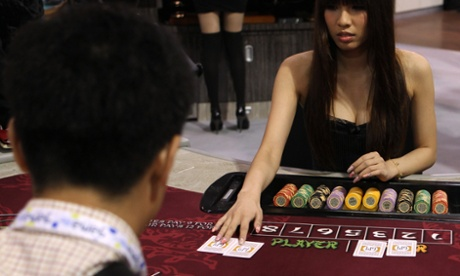 A hostess deals cards during a baccarat demonstration at The Venetian.