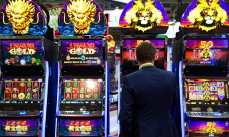 A gambler plays a 50 Lions slot machine at The Venetian casino.