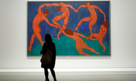 A visitor looks at The Dance by Henri Matisse as part of the opening of the exhibition
