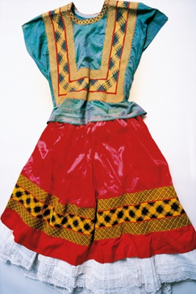 A corset-style bodice and long flowing skirt in vibrant colours were a signature silhouette for Kahlo.