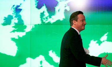 David Cameron passes a map of Europe at the Bloomberg offices in London, on 23 January 23, 2013.