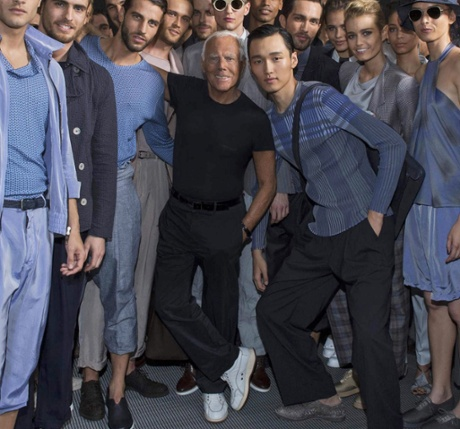 The designer with models at Milan Fashion Week.