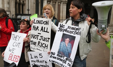 Demonstrators protest against government changes to the welfare system and the proposed 'bedroom tax' outside the high court on 15 May 2013 in London.