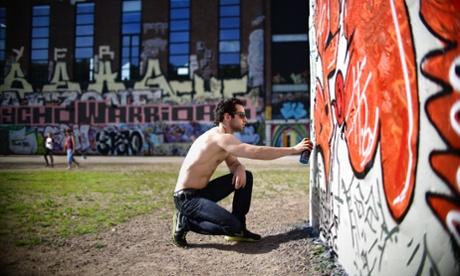 Gothenburg's most prominent graffiti artist Sarai, works on a new mural by the R da Sten Konsthall beside the lvsborg Bridge.