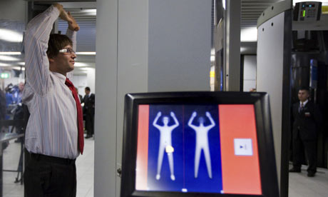 An employee at Schiphol airport, Amsterdam, tests new body scanners