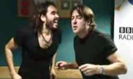 Russell Brand and Jonathan Ross in a BBC studio leaving messages on Andrew Sachs' answerphone