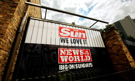 A News of the World and a Sun logo on the News International Newspapers building in Wapping